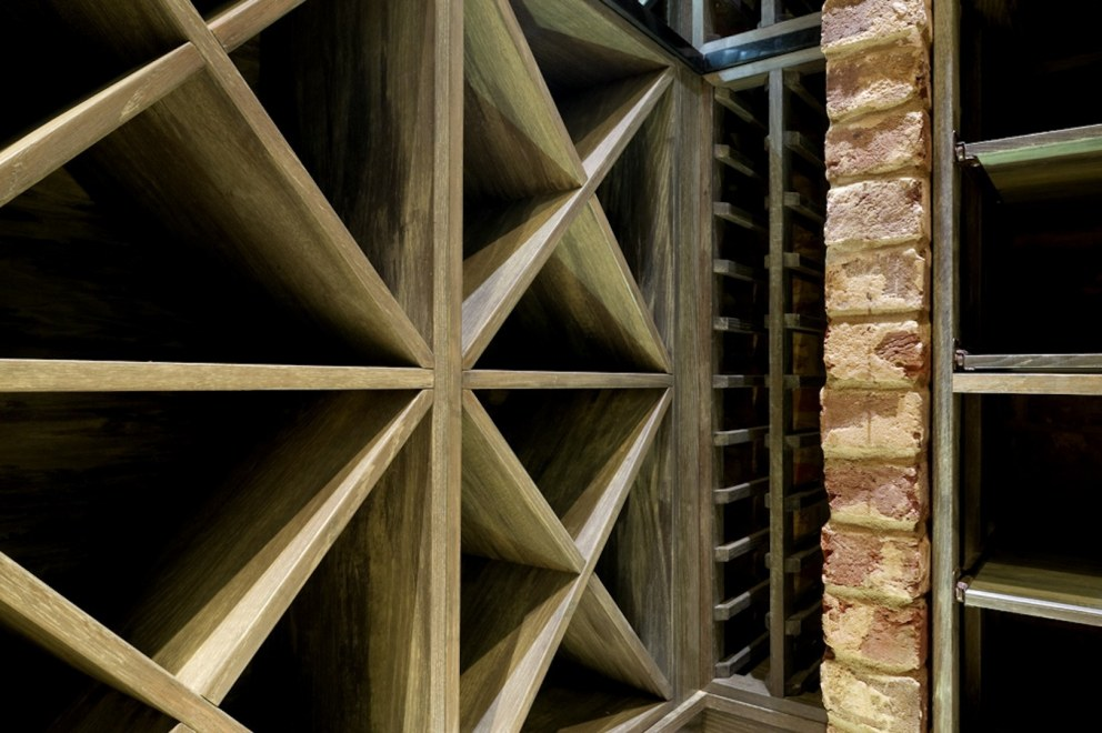 Wandsworth Edwardian basement swimming pool and gym | Detail of custom wine racking | Interior Designers