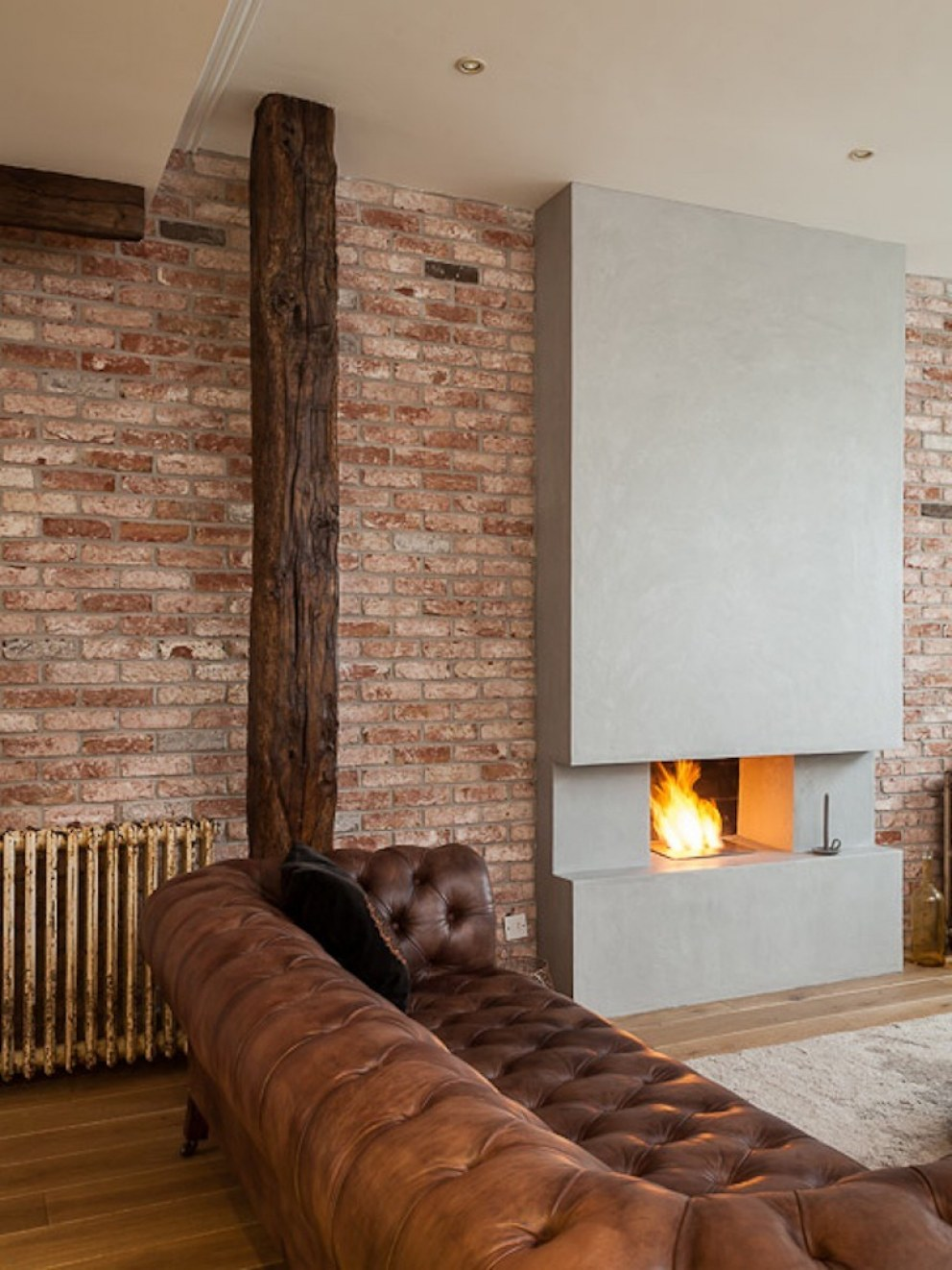 Post industrial chic in Fulham | Fireplace | Interior Designers