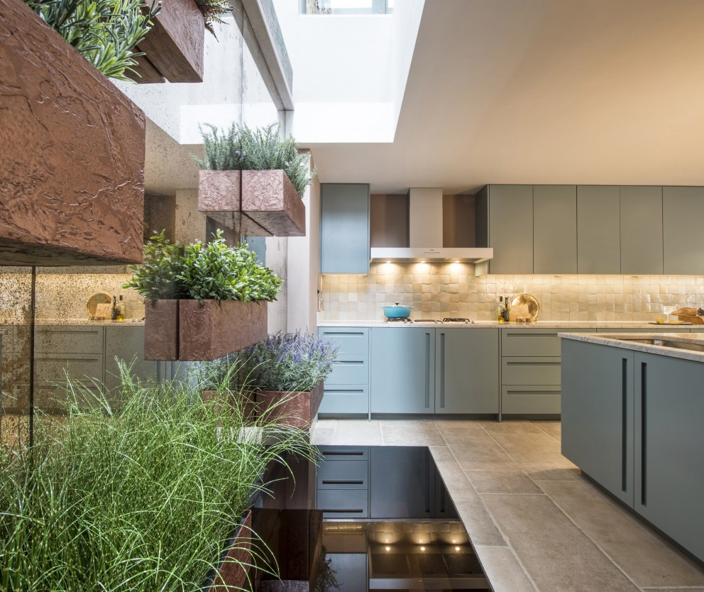 Architectural Mews House, Belsize Park | Kitchen Plant Wall | Interior Designers