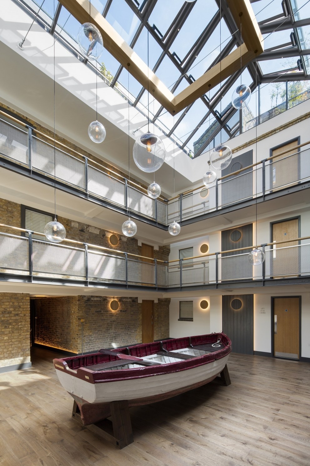 Main atrium with bespoke industrial chandelier and ...