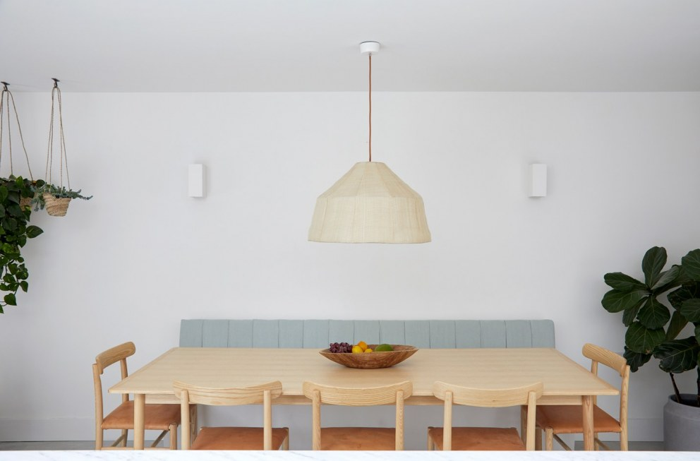 Brixton Townhouse II | Dining area with bespoke banquette seating | Interior Designers