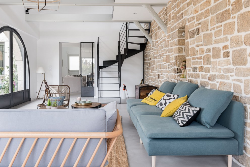 House in Brittany | Living room with steel staircase, stone wall and exposed beams 2 | Interior Designers